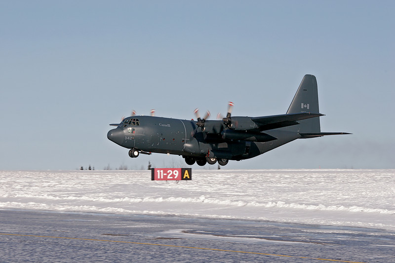 Canadian Armed Forces C-130 Hercules with the call sign 'Atlas 42' was in the Dryden area while out on a training flight. They're just leaving Dryden after picking up two crew members who parachuted from the aircraft. Taken this cold (-18C) day of March 5th, 2007.