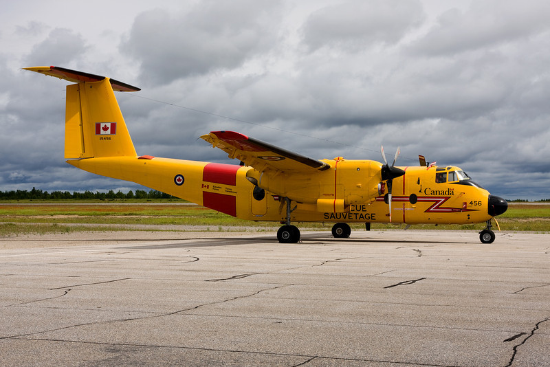 This De Havilland Canada CC-115 Buffalo (DHC-5D) (serial number 10) is sitting on the ramp at the Dryden airport after blowing an engine - as evident by the propellers: one engine is feathered, the other is not. <br /> <br /> It will be sitting here for about a week waiting for a boxed engine to be airlifted by a Hercules.