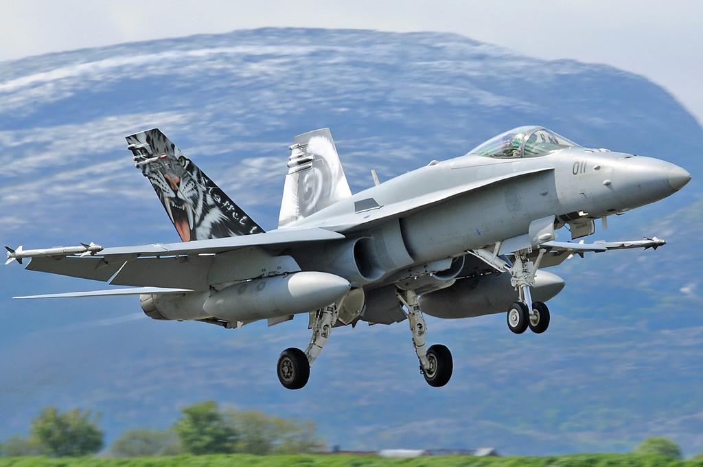 "NATO Tiger Meet at Ørland MAS (OLA/ENOL) on June 1, 2012. Swiss Air Force McDonnell Douglas F/A-18C Hornet ""J-5011"" (cn 1351/SFC011). Operated by Fliegerstaffel 11 based at Meiringen AB."