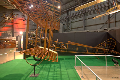 National Museum of the United States Air Force, Dayton, Ohio,   04/12/2019  Standard J-1 Used by the US Army Air Service in WWI for  flying instruction.    The fabric covering has been removed to show the wire-braced wood construction. Another view of the Fokker Dr 1 in the background.  This work is licensed under a Creative Commons Attribution- NonCommercial 4.0 International License.