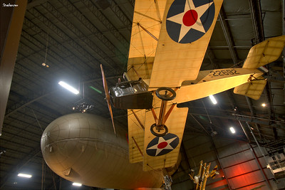 National Museum of the United States Air Force, Dayton, Ohio,   04/12/2019  Standard J-1 c/n 1141  22692,  to left a Caquot Type R Observation balloon, behind and to right a Fokker Dr 1 replica.  This work is licensed under a Creative Commons Attribution- NonCommercial 4.0 International License.