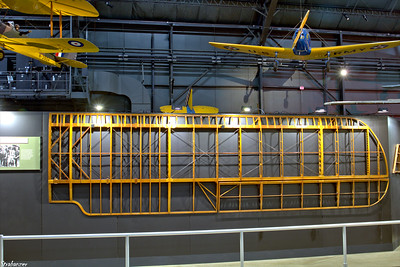 National Museum of the United States Air Force, Dayton, Ohio,   04/12/2019  Wod-and-wire construction of a wing.     Behind hangs a Fairchild PT-19A Cornell  This work is licensed under a Creative Commons Attribution- NonCommercial 4.0 International License.