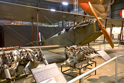 National Museum of the United States Air Force, Dayton, Ohio,   04/12/2019  Curtiss JN-4D Jenny    c/n 278   A2805 The Jenny was powered by the OX-5 engine seen on the right.  This work is licensed under a Creative Commons Attribution- NonCommercial 4.0 International License.