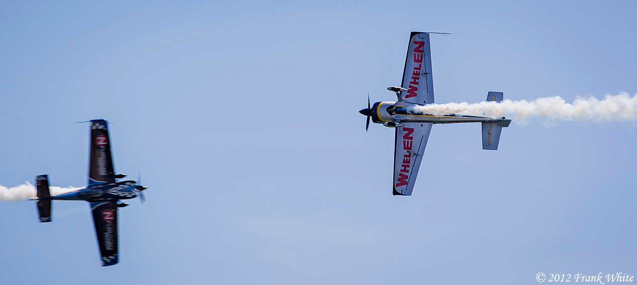 Rob Holland and Michael Goulian, aerobatic flyers, doing a close pass. Ocean City, MD 2012 Airshow.