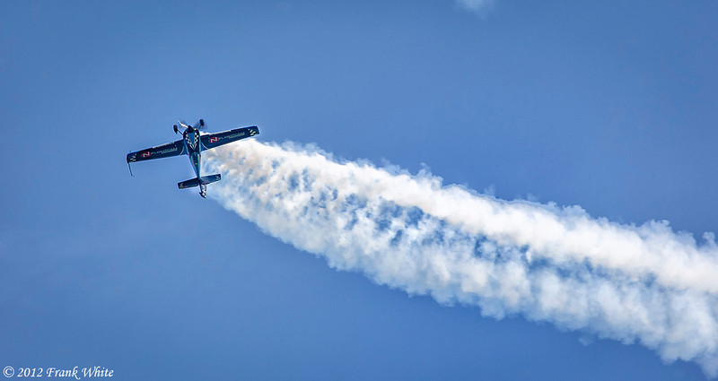 Rob Holland flying sideways and upside down in a MXS/RH aerobatic aircraft. Ocean City, MD 2012 Airshow.
