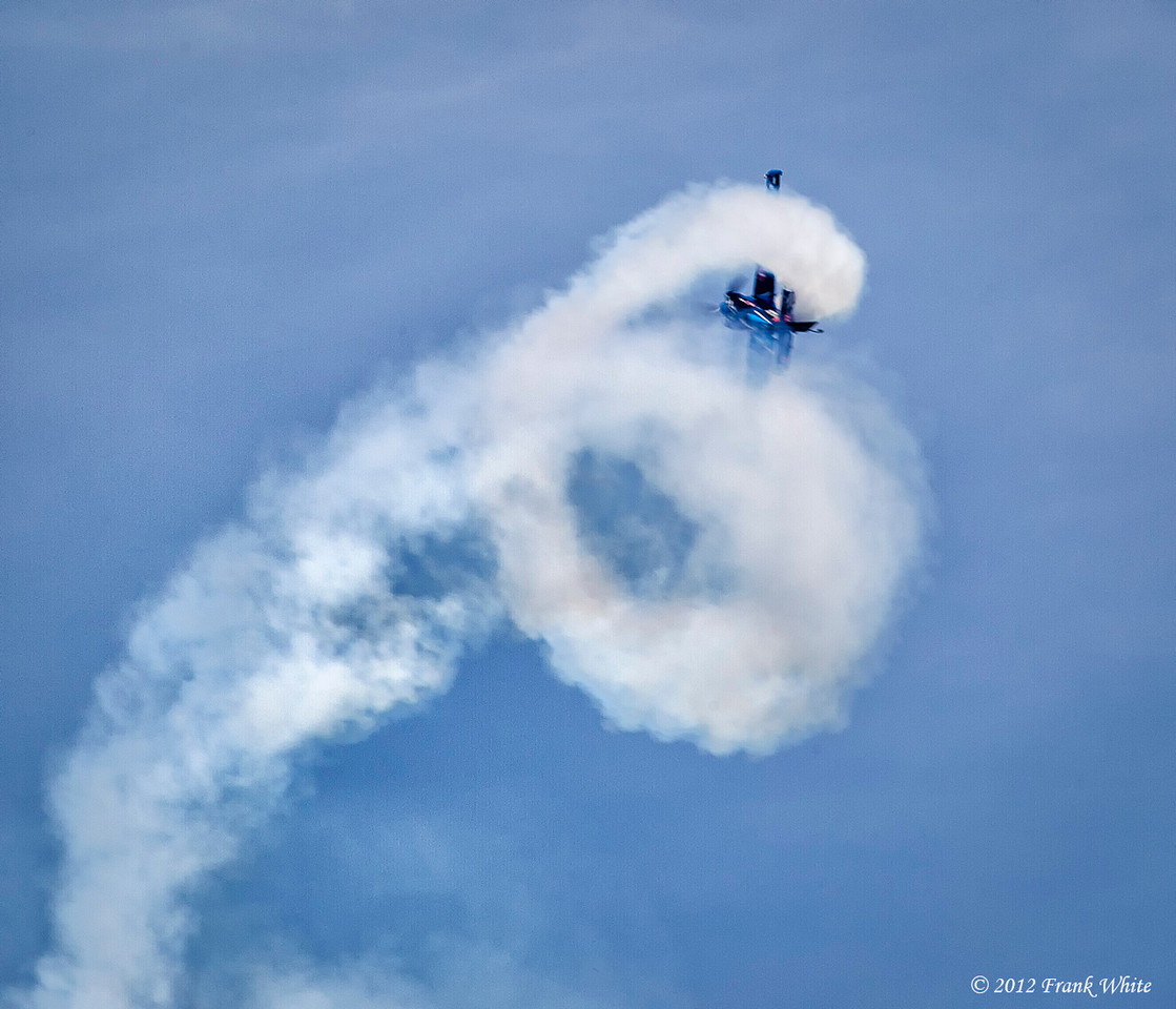 Rob Holland doing a tight series of barrel rolls in a MXS/RH aerobatic aircraft. Ocean City, MD 2012 Airshow.