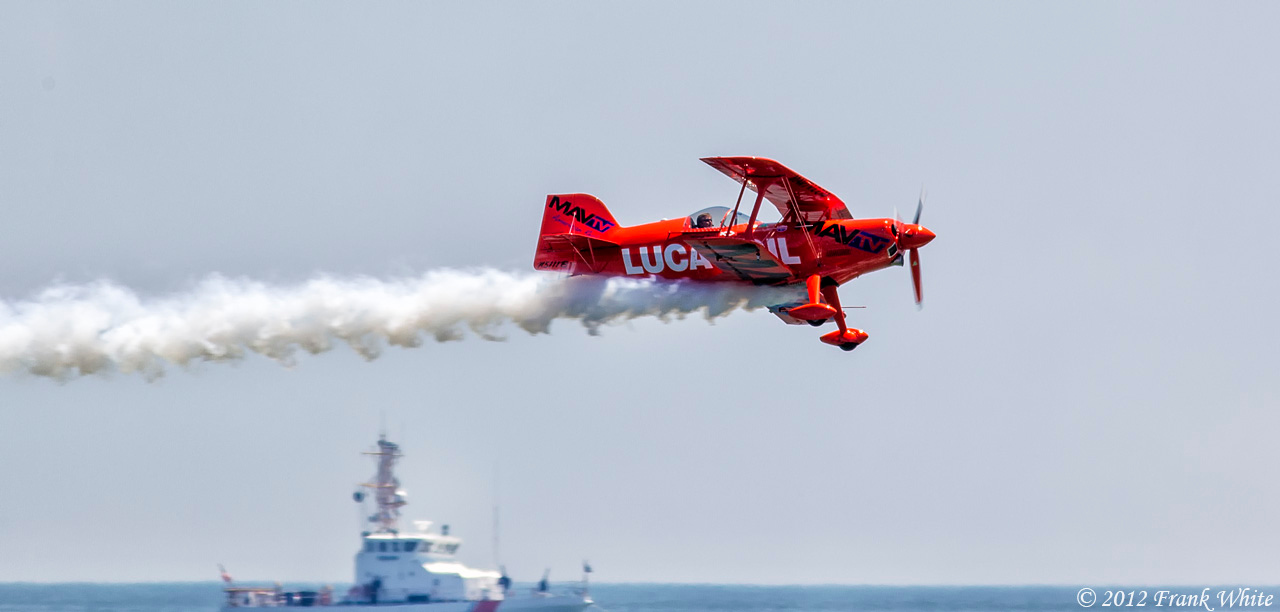 Mike Wiskus making a low pass over the water in the Lucas Oil Pitts Special aerobatic biplane. Ocean City, MD 2012 Airshow.
