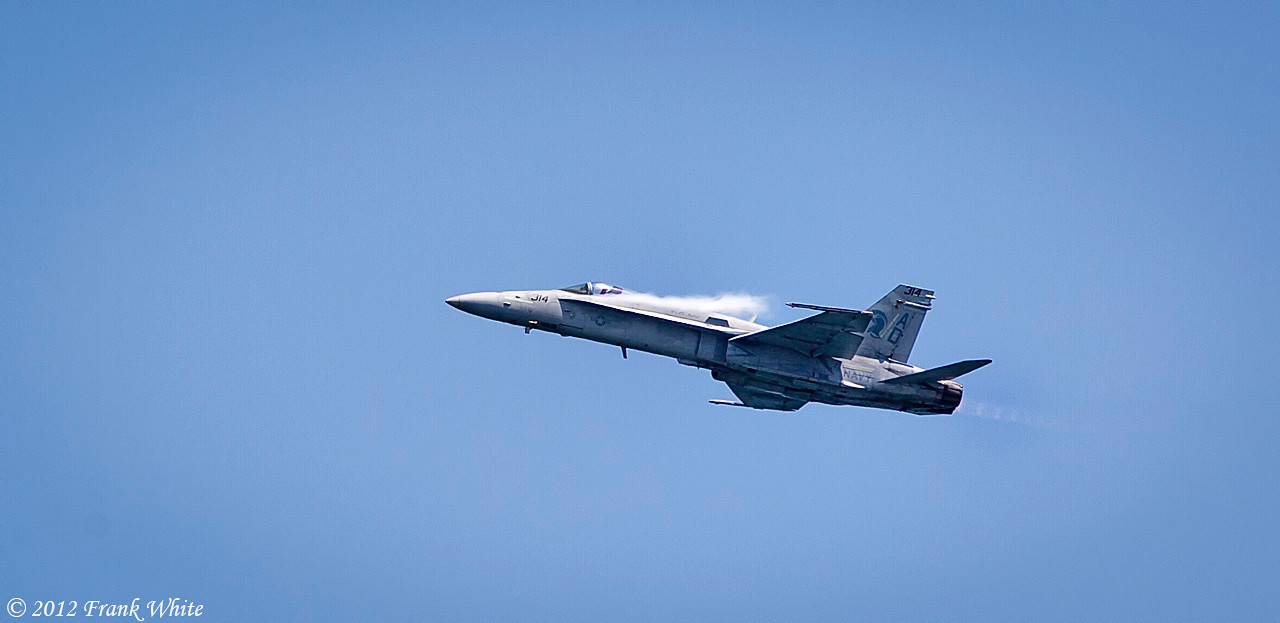 Navy F/A 18c Hornet. Notice the condensation coming off the wing as he pulls into a sharp climb. Ocean City, MD 2012 Airshow.