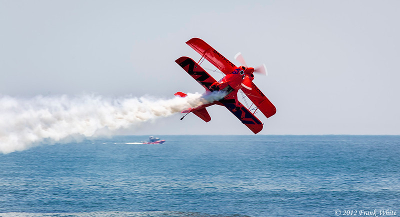 Mike Wiskus flying sideways along the beach in the Lucas Oil Pitts Special aerobatic biplane. Ocean City, MD 2012 Airshow.