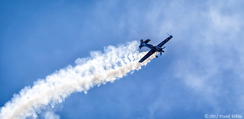 Michael Goulian flying sideways in an Extra 330 SC aerobatic aircraft. Ocean City, MD 2012 Airshow.