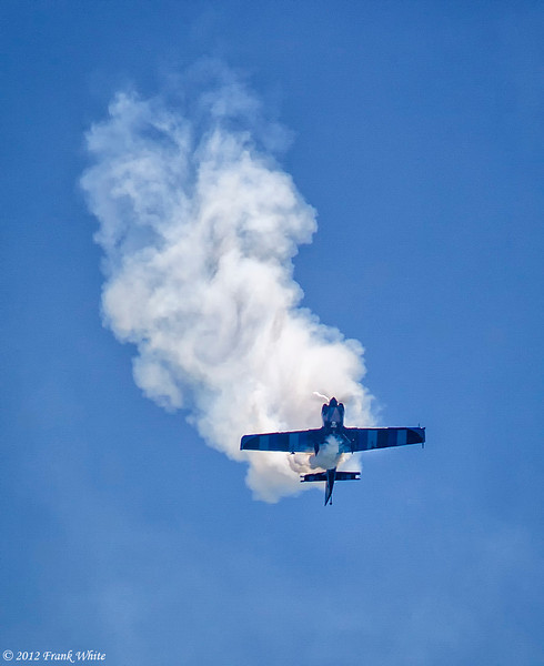 Rob Holland flying a MXS/RH aerobatic aircraft. He's in a flat spin coming down, just before a dive. Ocean City, MD 2012 Airshow.