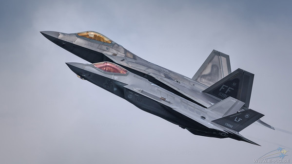 Lockheed Martin F-35A Lightning II & F-22A Raptor in a formation flight.
