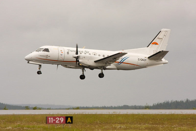 Transwest Air from Prince Albert Saskatchewan, leaves Dryden after dropping off MNR forest fire fighters in a SAAB 340A.