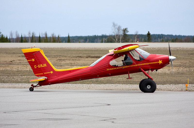 A Polish made Pezete PZL-104M Wilga 2000 gets ready to taxi out onto the runway at the Dryden airport.