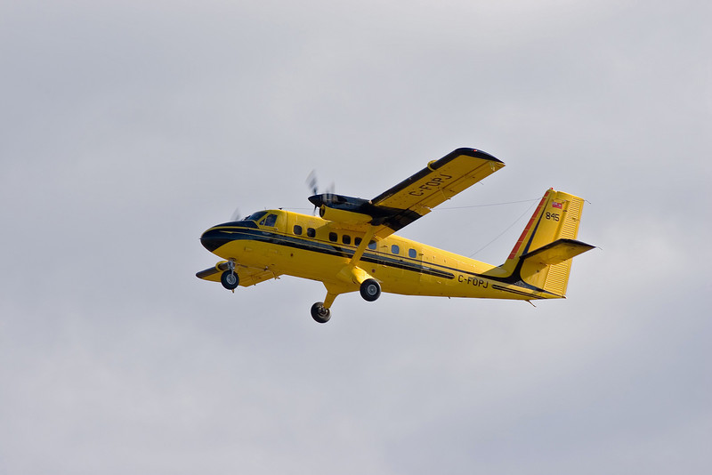 A twin Otter leaves Dryden without the floats that are usually attached.