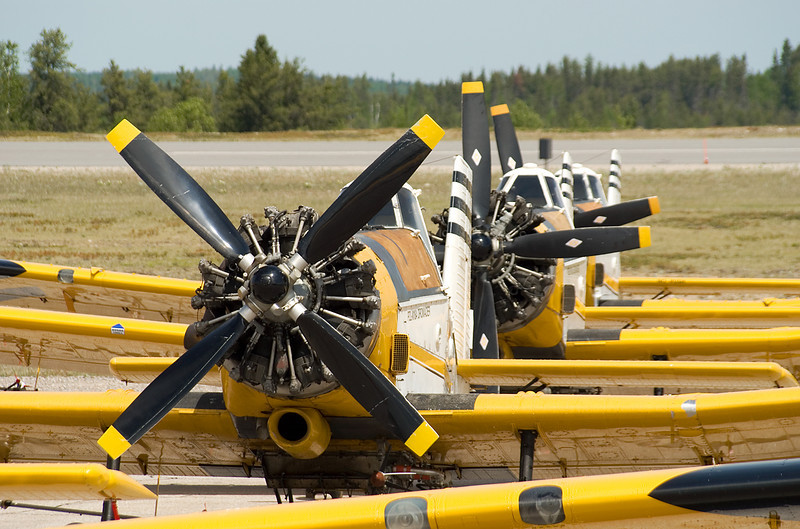 Three Pezetel M18's (PZL M-18) (DROMADER) sits on the ramp at the Dryden airport. At the time of this photo, there was 10 Dromaders sitting on the ramp with two still to arrive.
