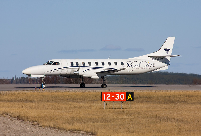 SkyCare about to taxi off of runway 30 at the Dryden Airport.