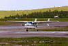 C-FJIP, a Cessna 337G of Hicks and Lawrence (Dryden) sits on the pad as a Bearskin Airlines metro (flt JV311) gets ready to leave Dryden.