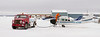 Four photo panorama of a Cessna U206F taking on fuel before a trip north.