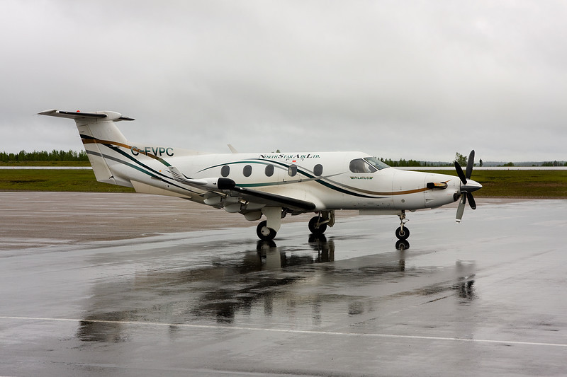 North Star Air sitting on the ramp at the Dryden airport with a Pilatus PC-12.