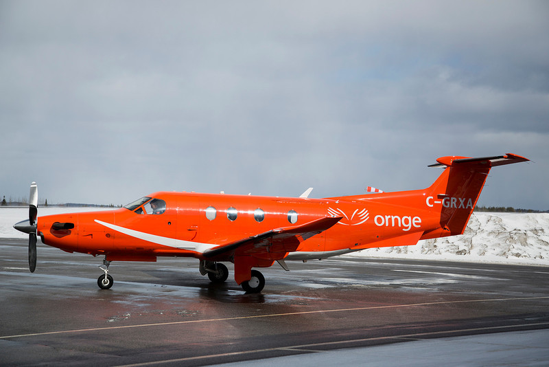 90 of 365 (Ornge)<br /> <br /> A Pilatus PC12 operated by Ornge. They were not in Dryden very long, just long enough to transfer a patient from an Ambulance to the aircraft for a trip to Thunder Bay.<br /> <br /> As you can tell by the windsock, it wasn't exactly a calm day out - winds were 23kts at the time of the photo.