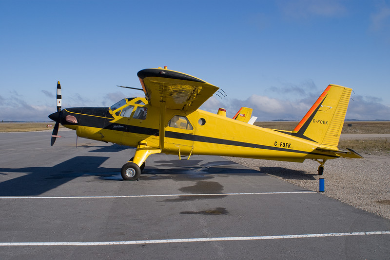 A Dehavilland DHC-2 MK. III (Turbo Beaver), Serial No: 1650TB28, sits on the ramp at the Dryden Regional Airport on Oct 15, 2007.<br /> <br /> This aircraft was built in 1966 but has in a museum from 1998 until now. She is being flown to BC as she was just sold/traded by MNR. This Turbo Beaver, and the one behind it (C-FOEU) left for BC 35 minutes after I took this photo.