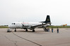 Calm Air uses a HS-748 to pick up forest fire fighters on a overcast day back in June 4th, 2005. MNR CL415 tanker 272 on the runway getting ito position to take off.