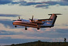 A Dehavilland DHC-8-103 owned by the Province Of Alberta, Department Of Public Works leaves the Dryden airport after dropping off Ontario MNR fire fighters in August of 2004. Photo taken late in the evening (7:46 PM) as the sun was going down.