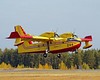 Quebec Tanker 244 (a Canadair CL-415) takes off to fight another fire.
