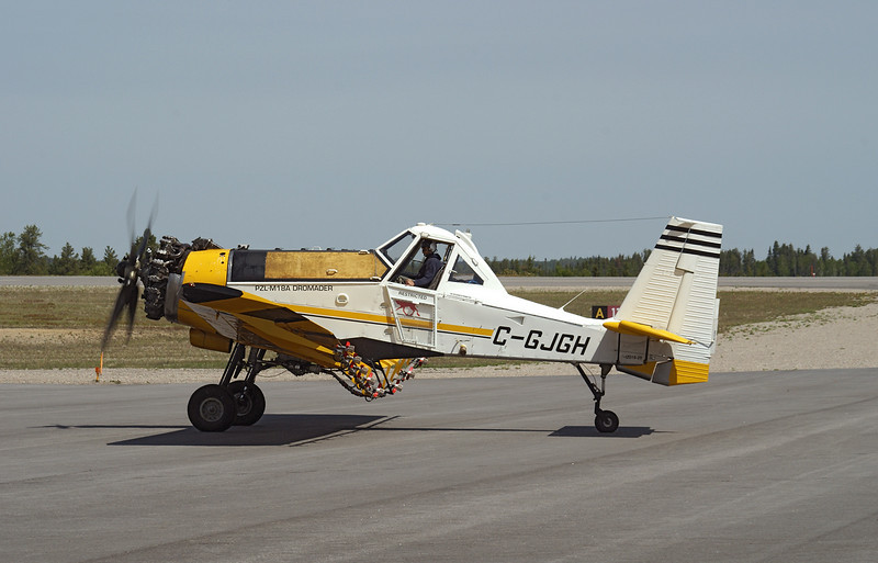 C-GJGH, a Pezetel PZL M-18 (DROMADER) taxis to position on the ramp at the Dryden Airport.