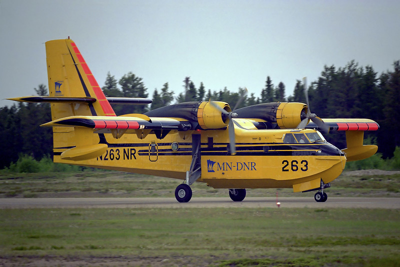 This CL-215 used to be owned but the Ontario MNR and stationed in Dryden but it is now owned by the Minnesota DNR. I believe the photo was taken in 2003 at the Dryden airport.