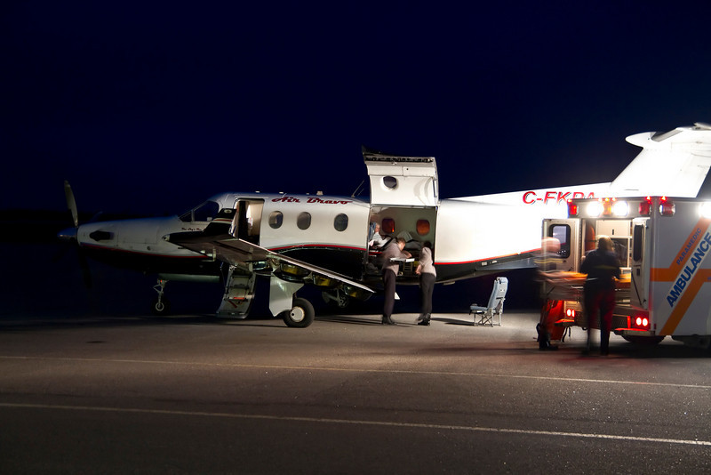 1/2 second at F2.8. Photo of a medivac flight as they transfer a patient from the ambulance to the aircraft.