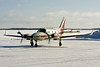 A Piper PA-31 Navajo (C-FOOO) sits on the ramp at the Dryden airport.