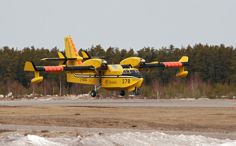 Ontario's MNR Tanker 278 (C-GOGZ), a CL-415, performs a touch and go during a day of training on this April (Friday) 13th, 2007 day. <br /> <br /> As you can see in the foreground, there is still some snow around - and the lakes are still iced up but no better time than the present to get those pilots and planes ready for a possible forest fire season.