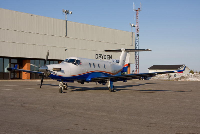 A Pilatus PC-12 recently purchased by Air Bravo (3 1/2 weeks previous to this photo), sits on the ramp next to the Dryden Regional Airport terminal building, early one morning.