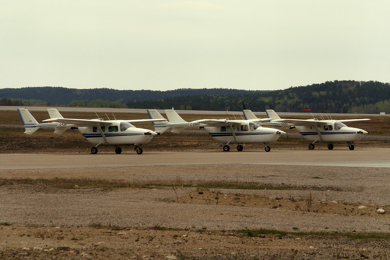 A trio of Cessna 337's at the Dryden Airport - C-FJIP, C-GNRO, and C-GIOG.