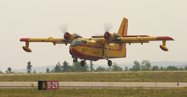 An older CL-215 Waterbomber, Tanker 217.<br /> <br /> The 215's use Avegas, where as the 415's use jet fuel.
