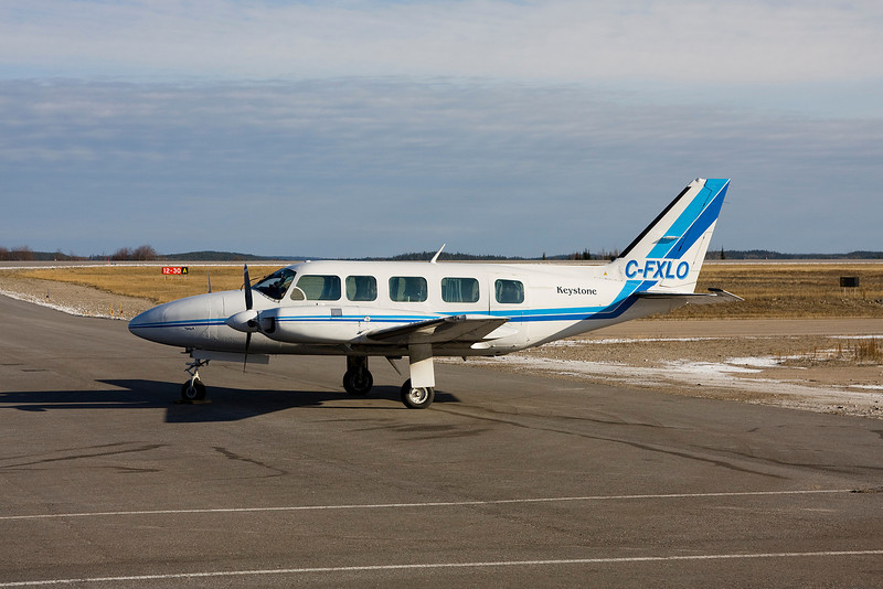 Keystone sitting on the ramp in Dryden with this Piper PA-31-350.