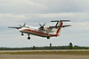 A 3/4 view of C-FCJD, a Dehavilland DHC-8-102 owned by Air Inuit Ltd, as she lifts off runway 29 on her way to Sudbury.<br /> <br /> The idea behind posting this image is to show you the wingspan of a Dash 8.