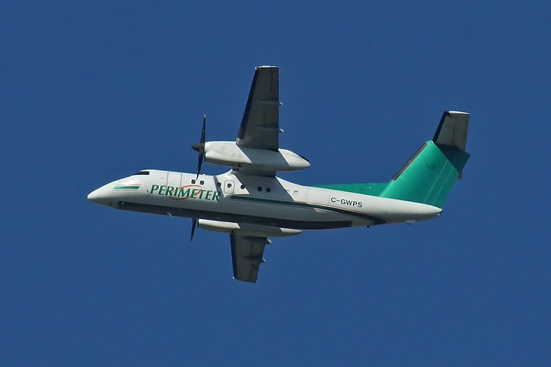 Perimiter Aviation crosses the sky in a Dehavilland DHC-8-102.