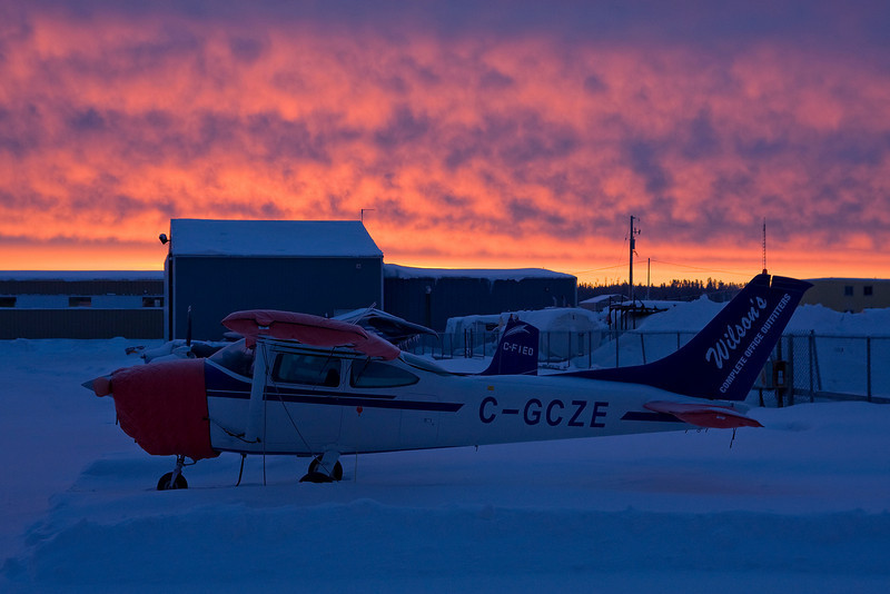 "Sunrise at the Dryden airport, on January 20th, 2009.  If you clicked on a link in the black and white gallery and were brought here - this photo was taken with a Canon 40D DSLR with a Tamron 17-50mm lens.  Link to the black and white version using a film camera loaded with b&w film: <a href=""http://www.djkennedy.com/gallery/6668412_bNXy3#462888068_QXH8N"">click</a>"
