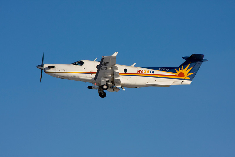 A Wasaya Pilatus PC-12 leaving Dryden on a sunny day.