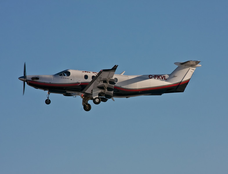Air Bravo just after taking off from runway 29 at the Dryden airport as a medi-vac flight in a Pilatus PC-12.