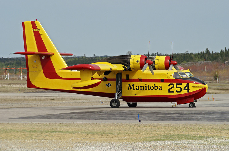 This CL-215 1A10 (tanker 254) is here in Dryden from Manitoba along with her sister, tanker 250, to help fight forest fires. On this day (May 6th, 2007) there is a forest fire near Sioux Lookout, Ontario. There where at least 5 water bombers fighting the fire.<br /> <br /> At the time of this photo, tanker 254 was sitting on the MNR ramp at the Dryden Airport waiting for another fire dispatch.