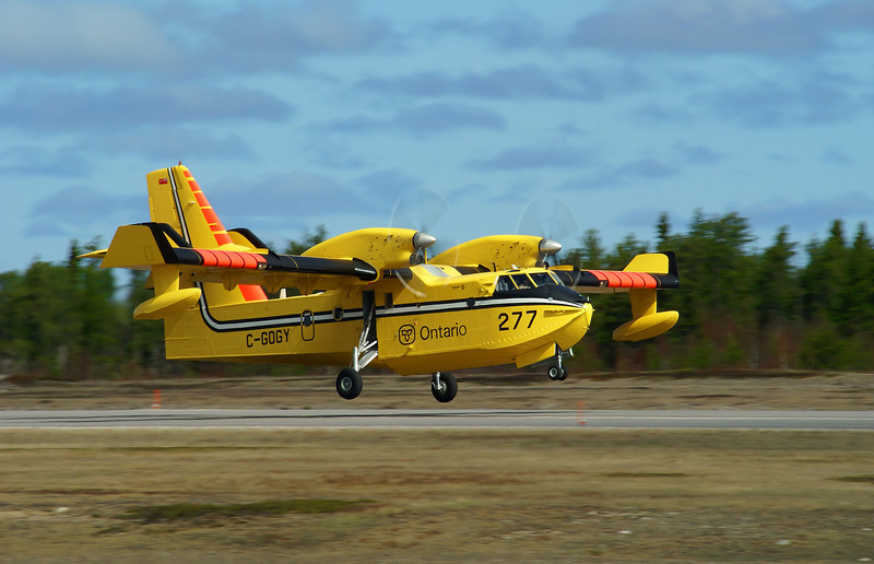 Fresh from re-fueling, a Bombardier CL-215-6B11 (CL-415), tanker 277 lifts off from runway 11 on her way to another fire dispatch.