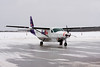 FedEx came to Dryden in this Cessna 208B Caravan to spend some time on the ramp due to freezing drizzle and freezing rain in the YWG area.<br /> <br /> Safe bet that the slogan 'The world on time' didn't apply to the shipments on this aircraft.