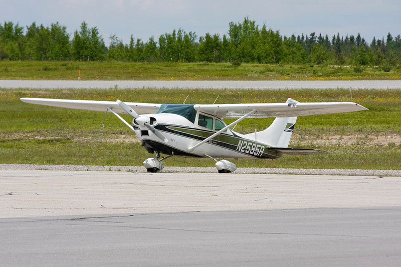 A Cessna 182K from Iowa tied down at the Dryden airport.