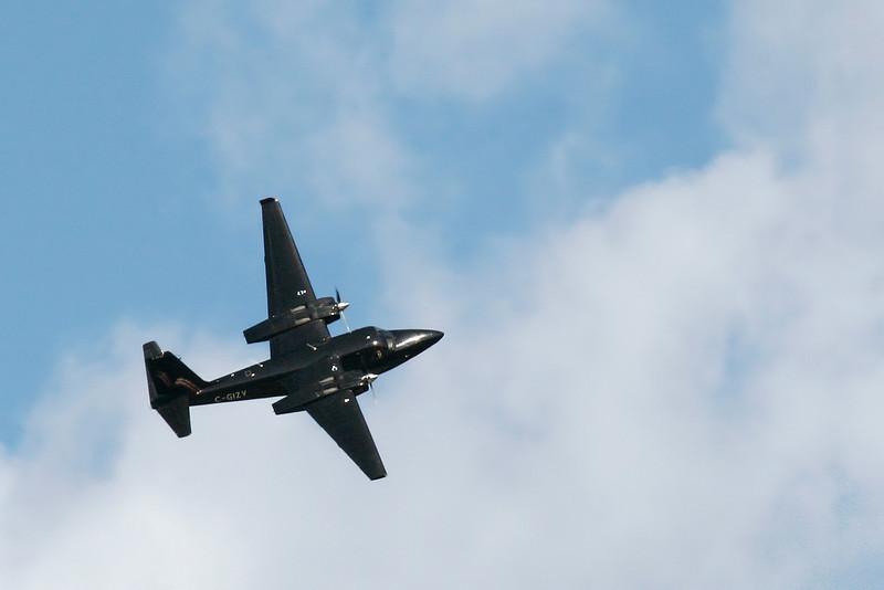 A Aero Commander 500B overhead the Dryden Airport.