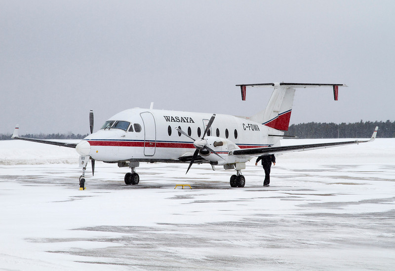 48 of 365 (Wasaya Beech 1900D)<br /> <br /> A very cold windy snowy day. This aircraft is waiting for the fuel truck (just out of frame, camera's left) before flying north.<br /> <br /> You are unable to see it in this photo, but the old Japanese registration is still visable on the starboard wing (JA016A). <br /> <br /> This aircraft has been around a bit, in 1994 Mountain West Airlines operated her(registration N75ZV), then 1998 Mesa Airlines (same registration), 2004 with Air Shenpix (registration JA016A), 2005 with Air Transse (same JA016A registration),in 2007 it was back in the US with Mansfield Heliflight (registration N175MH) and finally in November of 2008 she was registered in Canada with Wasaya Airways with the registration of C-FQWA.<br /> <br /> The paint scheme is of Air Shenpix (Japan).