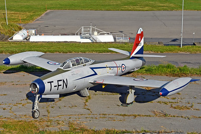 """Sandefjord Airport Torp (TRF) on September 13, 2013. Royal Danish Air Force Republic F-84G-6-RE Thunderjet """"A-803"""" (cn 51-9803). Put on display near the fire station. This aircraft is preserved, restored and repainted by local enthusiasts in Dakota Norway. It it repainted to represent Royal Norwegian Air Force F-84G-16-RE """"FN-T"""" (cn 51-10634) from 331 Squadron."""